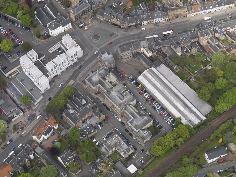 Oblique aerial view centred on the High Street, taken from the SW.