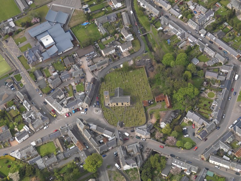 Oblique aerial view centred on the parish church, taken from the S.