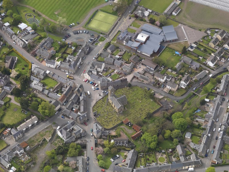 Oblique aerial view centred on the parish church, taken from the SE.