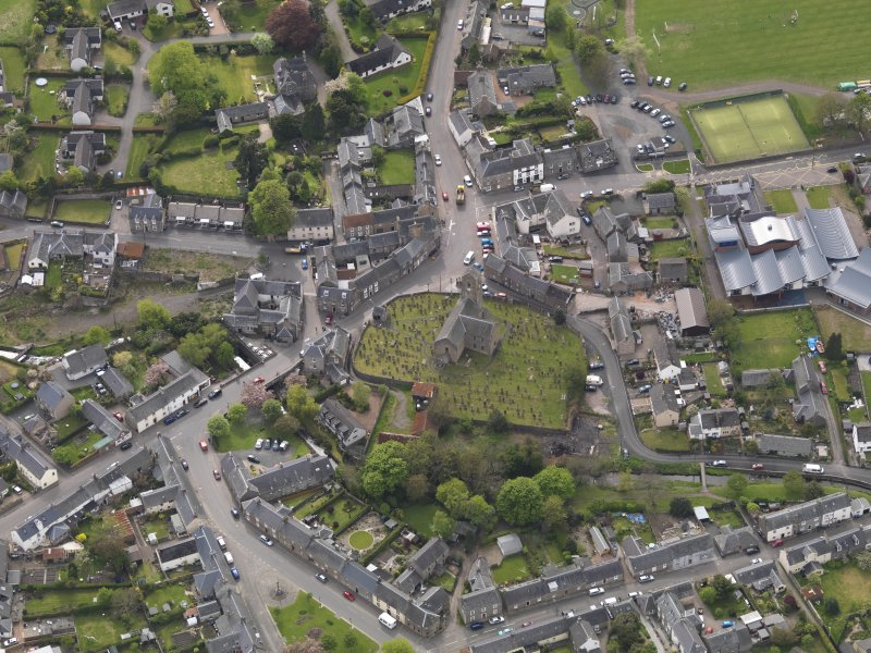 Oblique aerial view centred on the parish church, taken from the N.