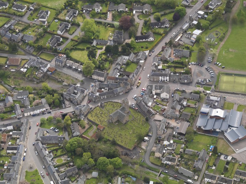 Oblique aerial view centred on the parish church, taken from the NNW.