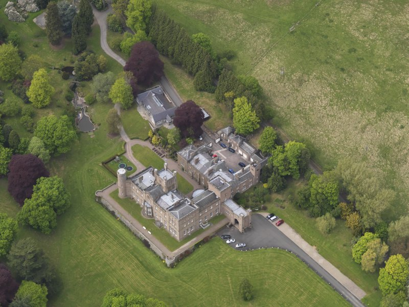 Oblique aerial view centred on the country house, taken from the SSE.