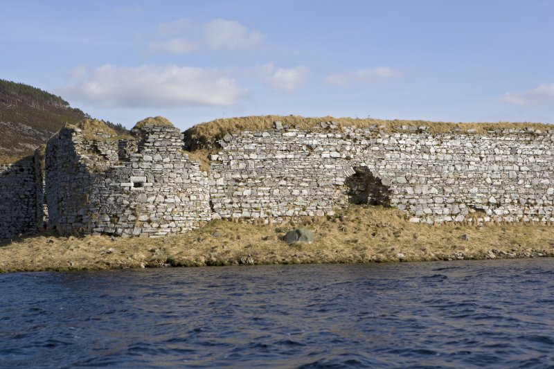 W wall, NW turret and blocked entrance, view from loch to WNW
