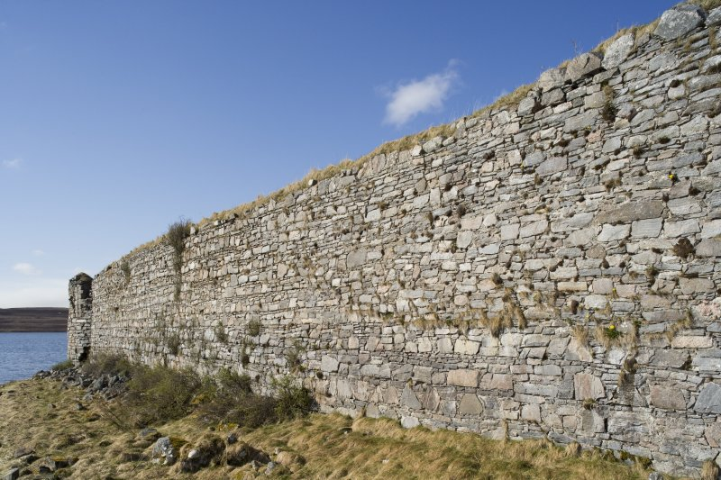 S wall, oblique view from SE