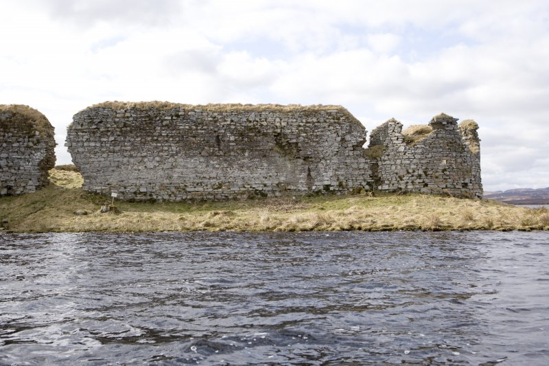 N wall, W end and NW turret, view from loch to N