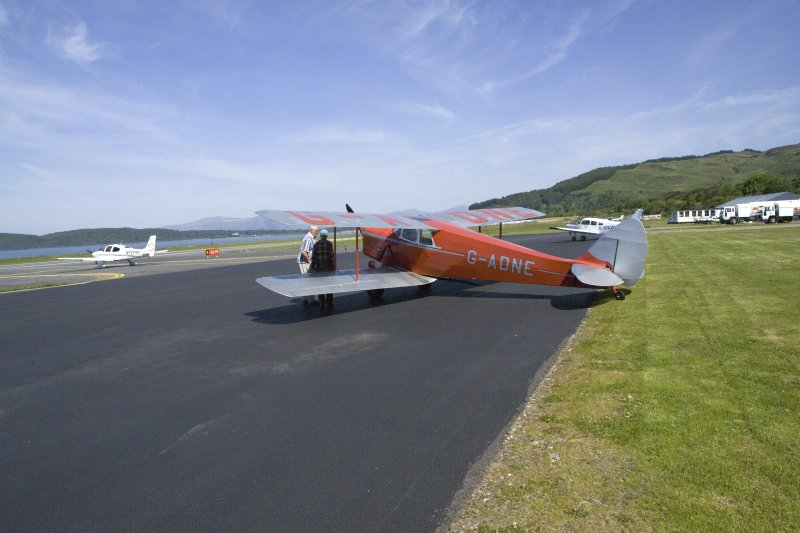 de Havilland DH87B Hornet Moth (G-ADNE) on the apron at Oban Airport (North Connel). Aircraft formerly owned by Ted Fresson.