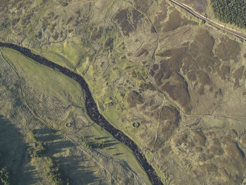 Oblique aerial view of the remains of the townships buildings and head dykes and the sheepfold, taken from the SW.