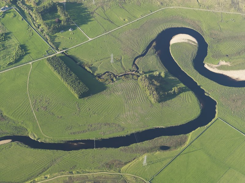 Oblique aerial view of the remains of the rig on the flood plain of the River Brora, taken from the SW.