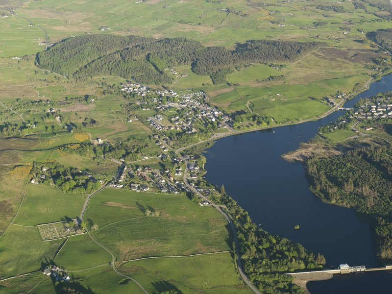 General oblique aerial view of Lairg with the power station, dam and crannog in the foreground, taken from the NW.