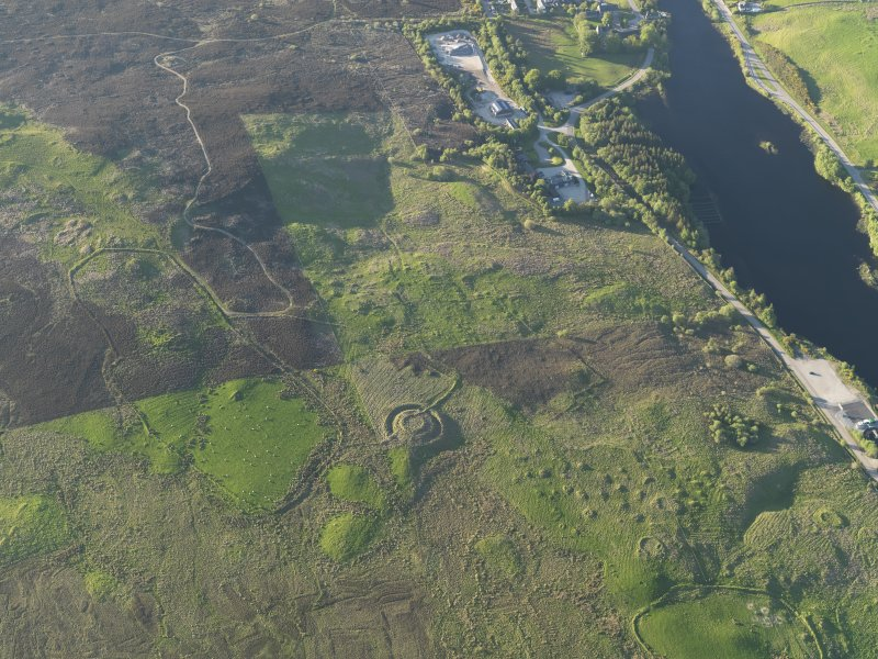 General oblique aerial view of the settlement enclosure on The Ord, Lairg, taken from the SSW.