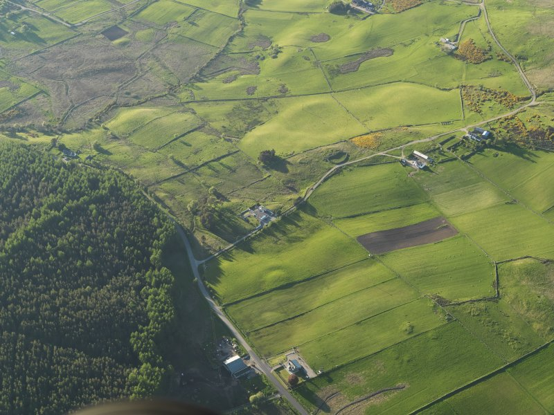 Oblique aerial view of the barrow at Knock Dhu with Balcharn beyond, taken from the S.