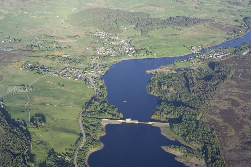 General oblique aerial view of Lairg with the power station, dam and crannog in the foreground, taken from the WNW.