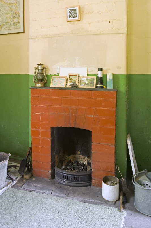 Interior.  Detail of fireplace in ticket office.
