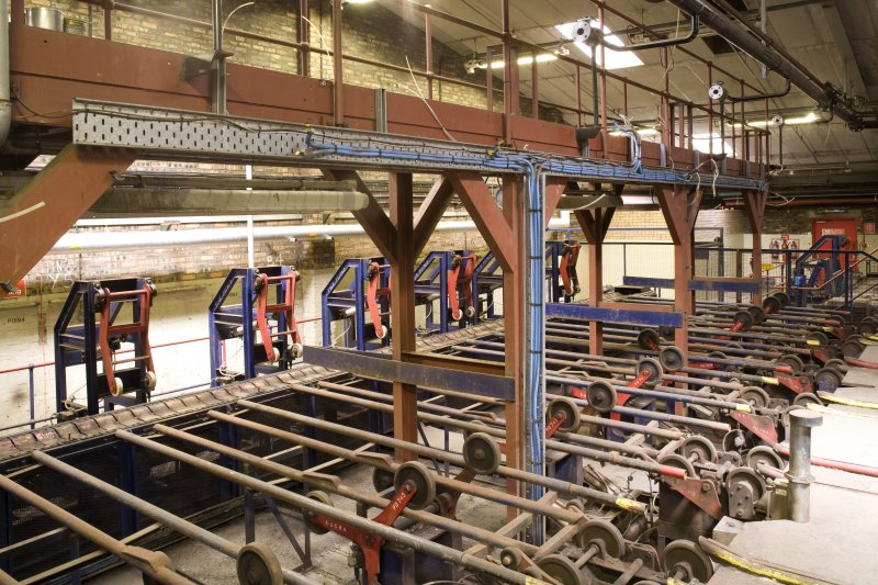Interior view of Port Dundas Distillery, Glasgow. Spirit store, detail of cask pushers and conveyor. The partially dismantled cask filling stations were in the area of the gantry.