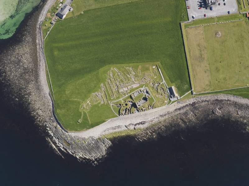 Oblique aerial view of the excavated settlement, broch and lairds house at Jarlshof, taken from the SW.