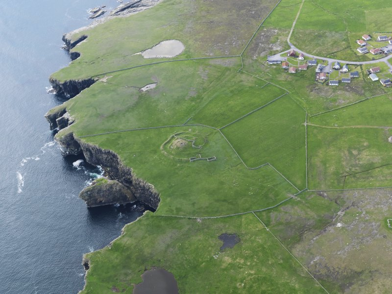 Oblique aerial view centred on the broch at Dalsetter, taken from the NE.