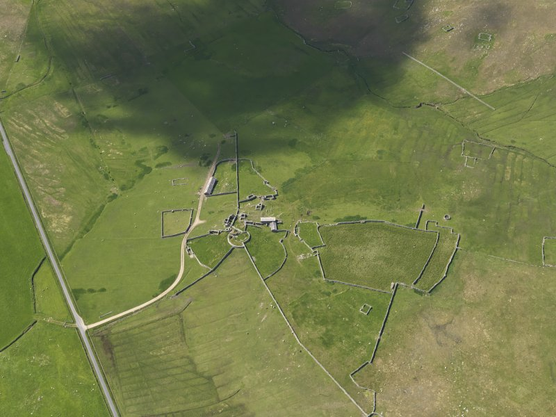 Oblique aerial view of Clumlie broch and township, looking to the SSW.