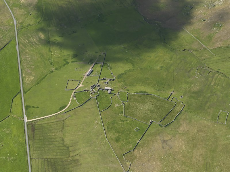 Oblique aerial view of Clumlie broch and township, looking to the S.