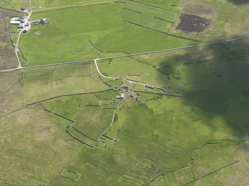 Oblique aerial view of Clumlie broch and township, looking to the E.