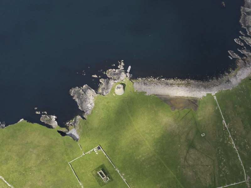 Oblique aerial view centred on the Broch of Mousa with The Haa adjacent, taken from the SE.