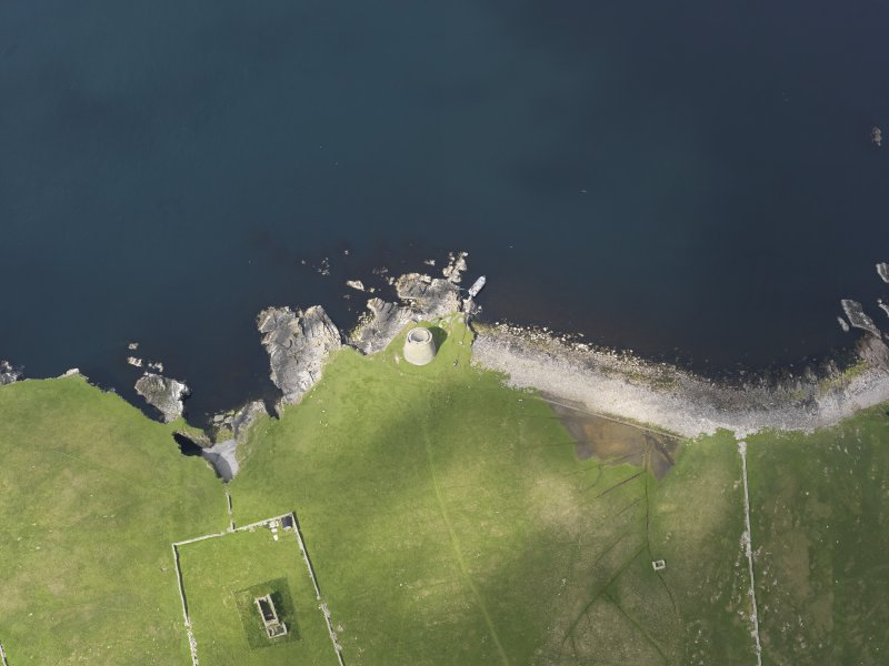 Oblique aerial view centred on the Broch of Mousa with The Haa adjacent, taken from the ESE.