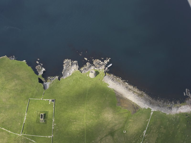 Oblique aerial view centred on the Broch of Mousa with The Haa adjacent, taken from the E.