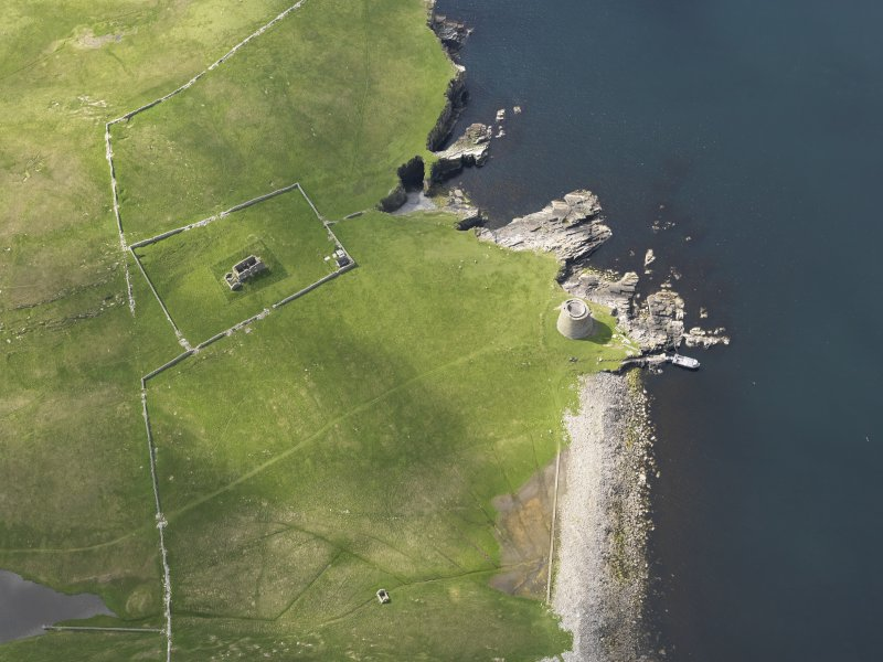 Oblique aerial view centred on the Broch of Mousa with The Haa adjacent, taken from the NNE.