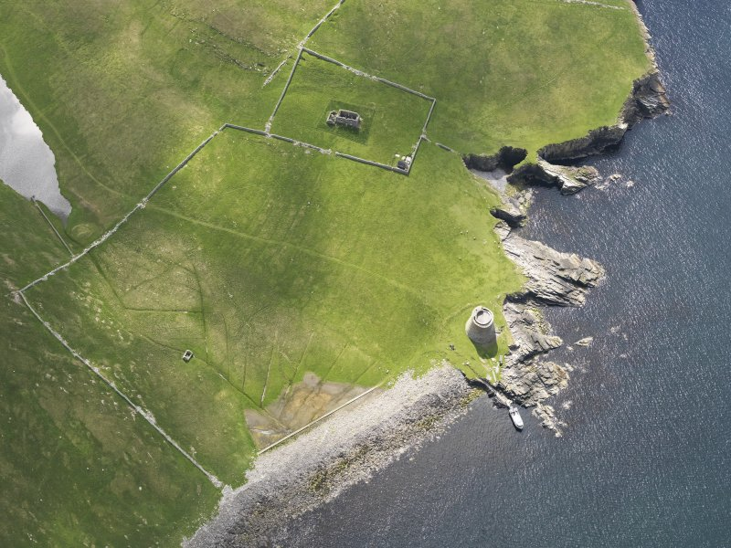 Oblique aerial view centred on the Broch of Mousa with The Haa and the burnt mound adjacent, taken from the NNW.