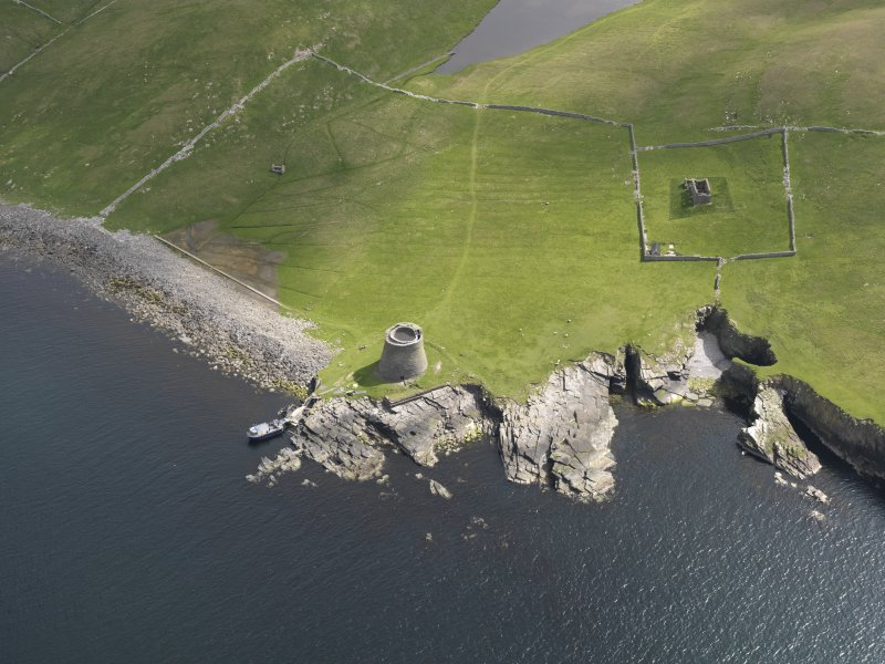 Oblique aerial view centred on the Broch of Mousa with The Haa and the burnt mound adjacent, taken from the WSW.