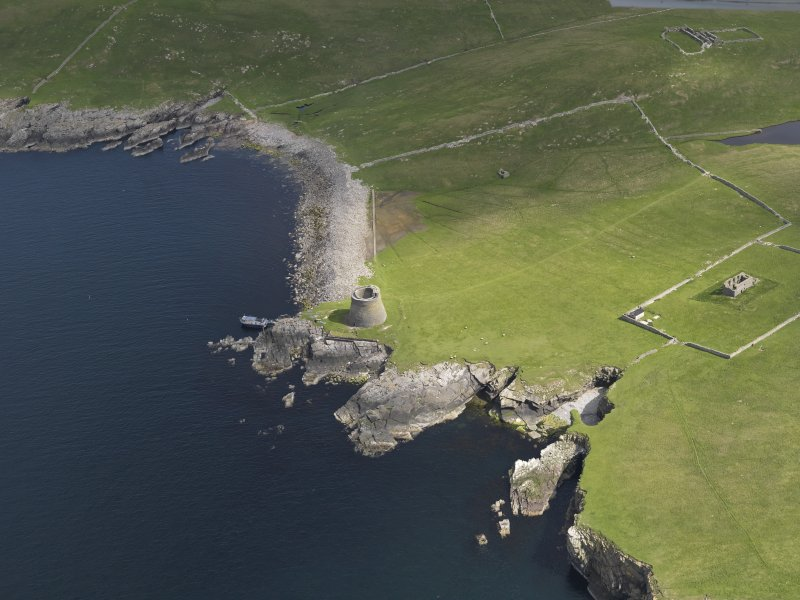 Oblique aerial view centred on the Broch of Mousa with The Haa adjacent, taken from the SW.