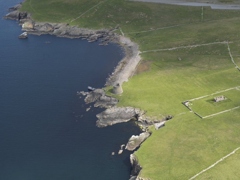 Oblique aerial view centred on the Broch of Mousa with The Haa adjacent, taken from the S.