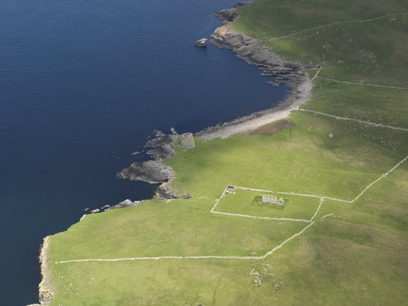 General oblique aerial view centred on the Broch of Mousa with The Haa adjacent, taken from the S.