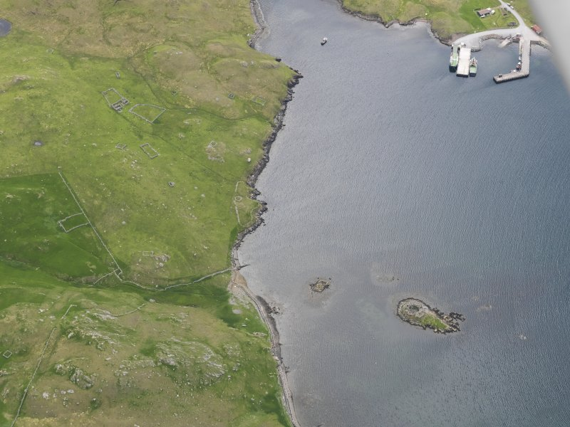 Oblique aerial view of the broch at West Burra Firth, looking S.