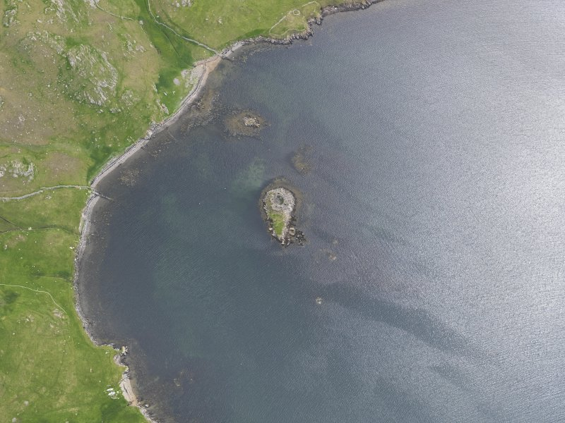 Oblique aerial view of the broch at West Burra Firth, looking SE.