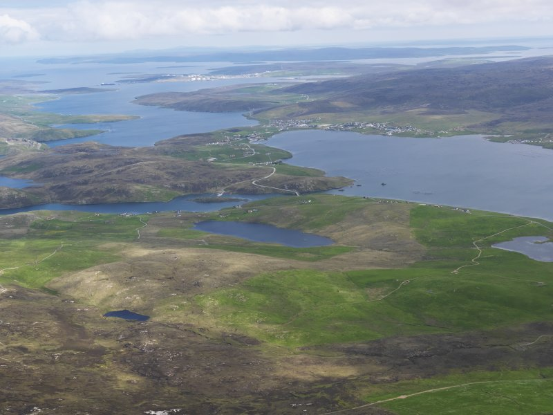 General oblique aerial view of Busta Voe and Brae village with Sullom Voe beyond, looking NE.