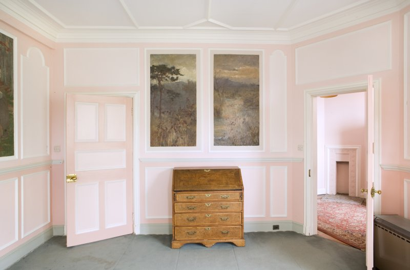 Interior.View of the west wall in the rear drawing room, with the connecting door to child's bedroom open and writing desk to centre.