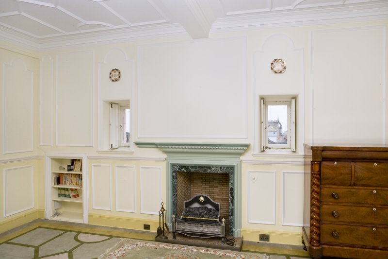 Interior. View of fireplace and flanking openings on the east wall of the main drawing room