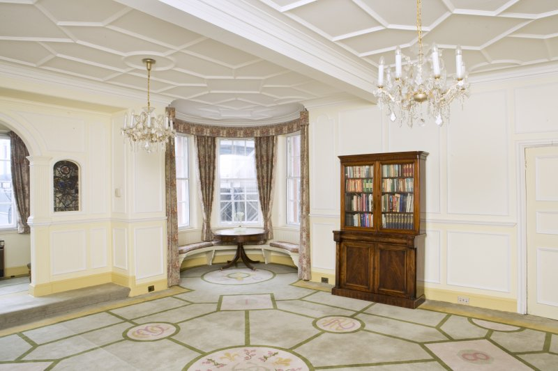 Interior. View looking into the south west corner of the main drawing room, including corner turret with window seat