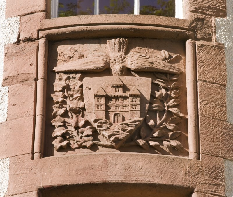 Entrance stair tower. Carved armorial panel. Detail