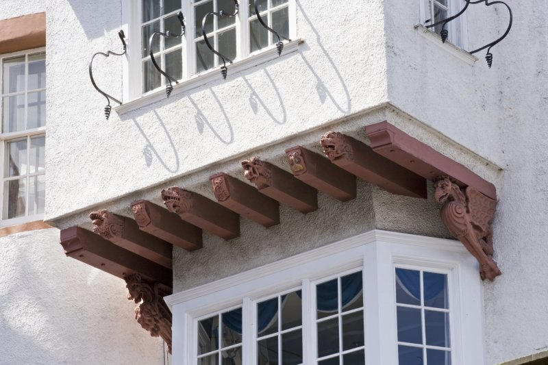 Cantilevered boudoir. Carved supporting brackets. Detail
