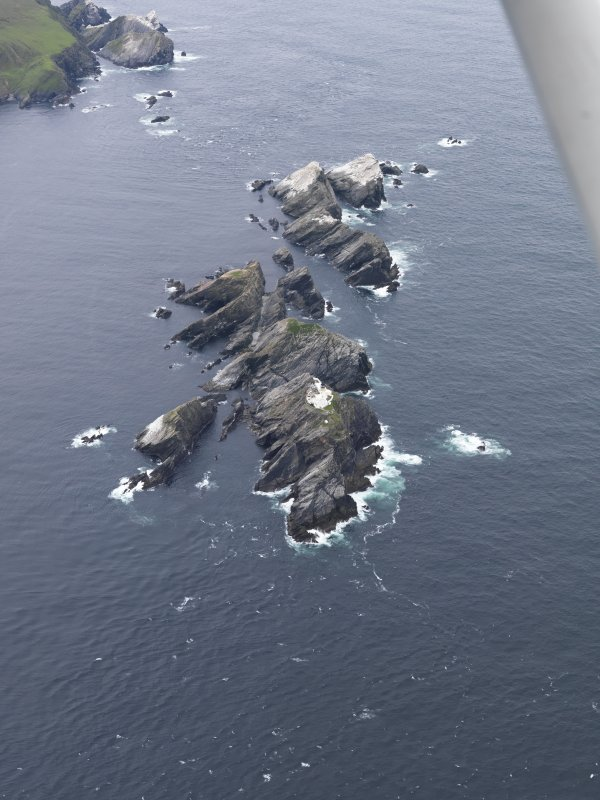 Oblique aerial view of North Unst Lighthouse, Muckle Flugga, looking SW.