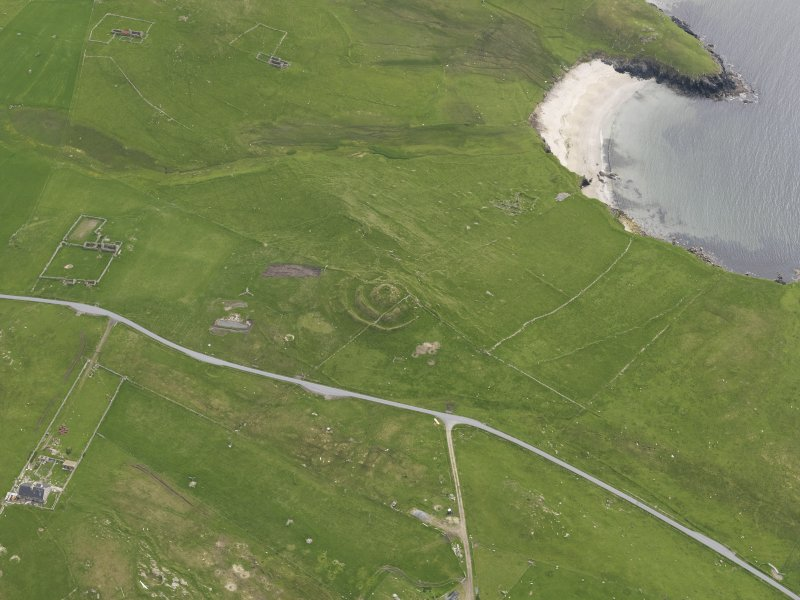 Oblique aerial view of the Broch of Underhoull and the field systems, looking SSW.