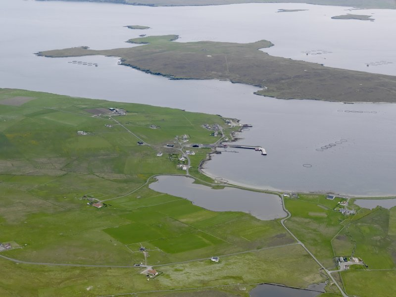 General oblique aerial view of Uyeasound with the island of Uyea beyond, looking SSW.