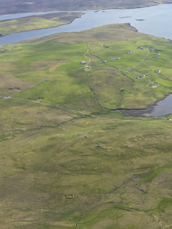 General oblique aerial view with Stanydale in the foreground and Gruting beyond, looking SSE.