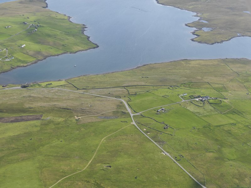 General oblique aerial view of West Houlland with Gruting and Scutta Voe beyond, looking SSE.