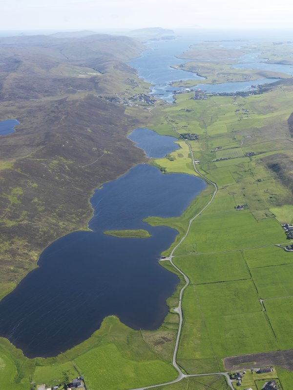 General oblique aerial view of the Loch of Tingwall with the Law Ting Holm in the foreground and Scalloway in the distance, looking SSW.
