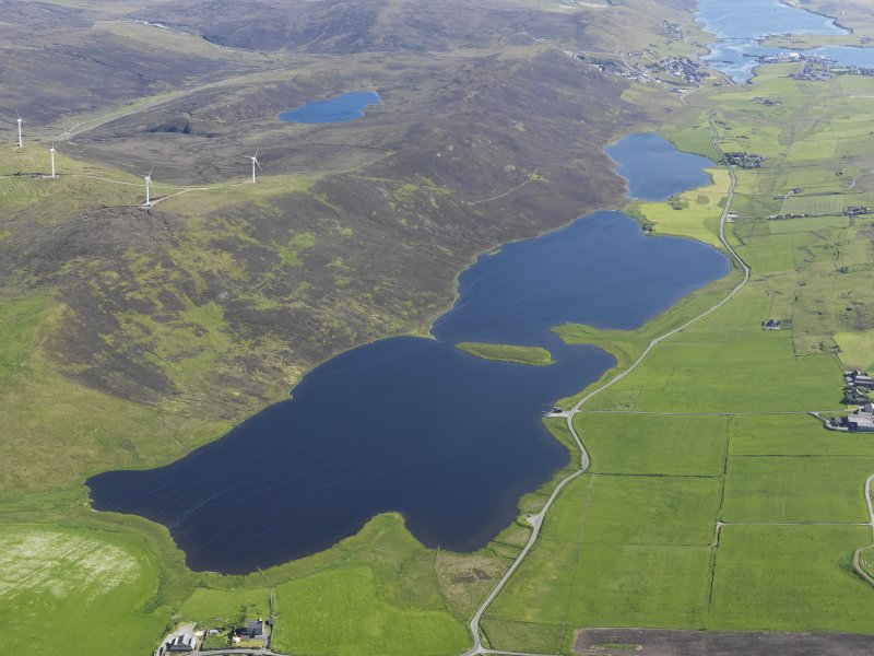 General oblique aerial view of the Loch of Tingwall with the Law Ting Holm in the foreground and Scalloway in the distance, looking S.