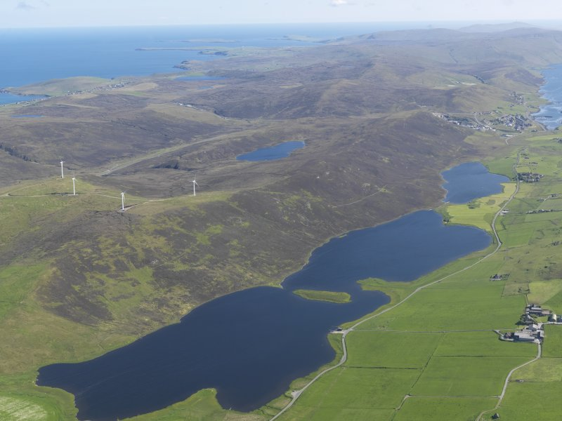 eneral oblique aerial view of the Loch of Tingwall with the Law Ting Holm in the foreground and Scalloway in the distance, looking S.