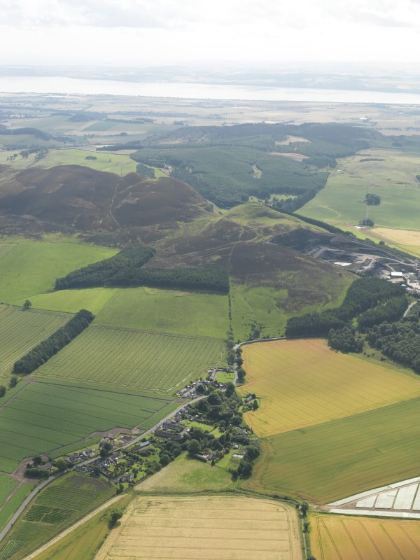 General oblique aerial view lookig across Collace towards Dunsinane Hill and the Carse of Gowrie and Firth of Tay beyond, taken from the NW.