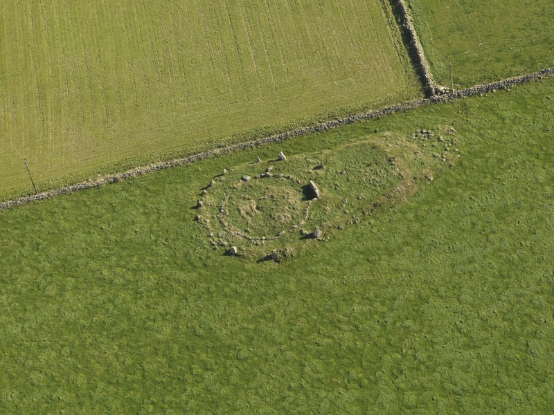 Oblique aerial view of the remains of the recumbent stone circle at Aquhorthies, taken from the WNW.